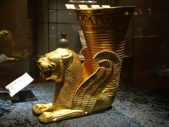 Vessel terminating in the forepart of a lion, Achaemenid, 5th century B.C., Iran. Gold; H. 6.7 in. (17 cm)